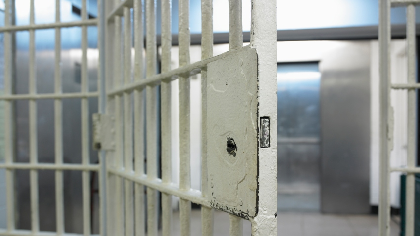 Stock photo of an open jail door