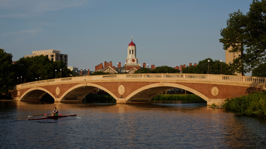 In a file photo, a sculler rows on the Charles River past the Harvard University campus in Cambridge, Massachusetts, U.S., on Tuesday, June 30, 2015. Harvard University, established in 1636, is the United States' oldest institution of higher learning. Photographer: Victor J. Blue/Bloomberg via Getty Images