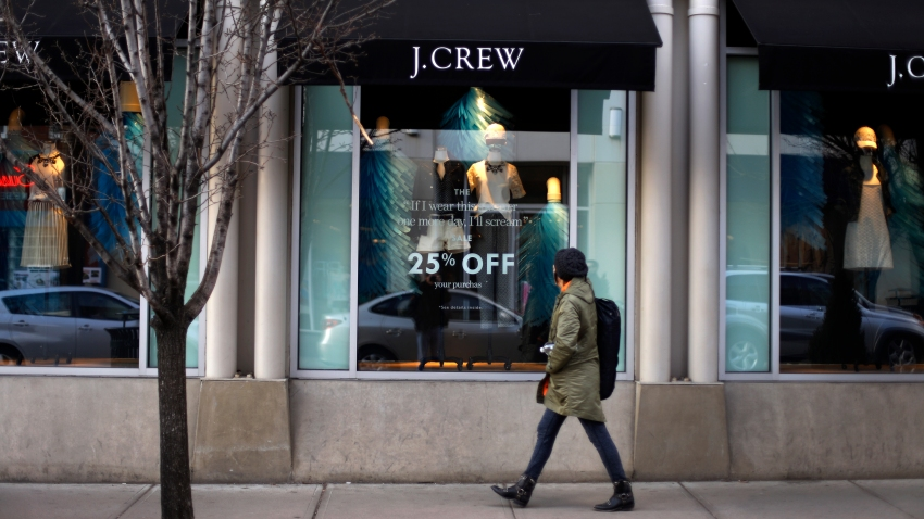 In this March 24, 2014, file photo, a pedestrian passes a J.Crew store in the Shadyside shopping district of Pittsburgh.