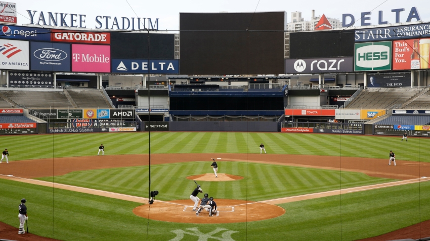 New York Yankees starting pitcher J.A. Happ throws to Miguel Andujar during the first inning of an intrasquad baseball game Monday, July 6, 2020, at Yankee Stadium in New York.
