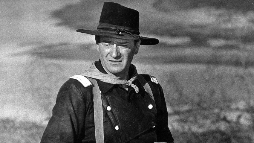 "In this undated photo, John Wayne appears during the filming of ""The Horse Soldiers."" In the latest move to change place names in light of U.S. racial history, leaders of Orange County's Democratic Party are pushing to drop film legend Wayne's name, statue and other likenesses from the county's airport because of his racist and bigoted comments."