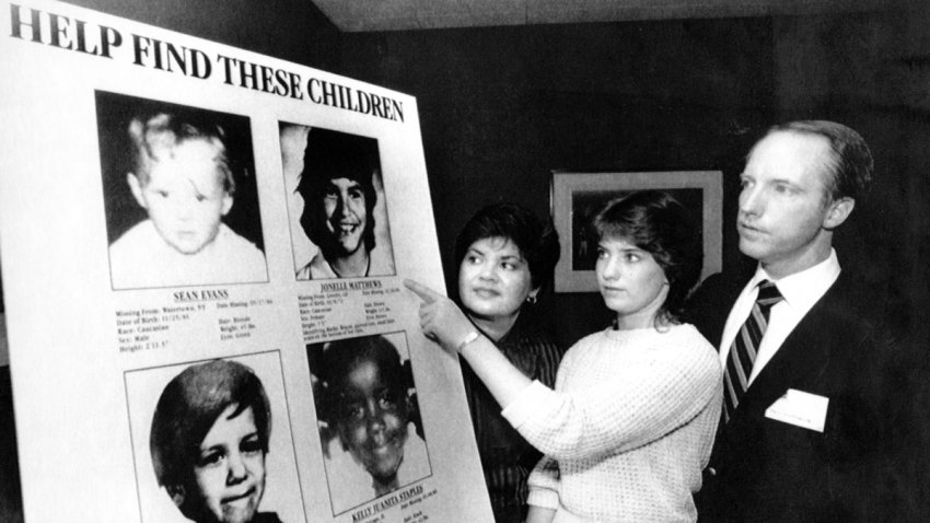 In this April 19, 1985, file photo, Jennifer Matthews, 16, points to a photo of her missing sister, Jonelle, 13, as parents Gloria and Jim Matthews, of Boulder, Colorado, in New York.