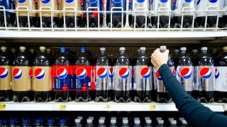 In this Feb. 7, 2012, file photo, a shopper reaches for a bottle of PepsiCo Inc.'s Diet Pepsi soda in a grocery store in Atlanta, Georgia.