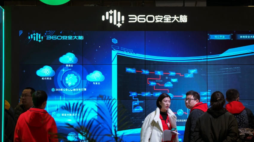 """In this Nov. 21, 2019, file photo, visitors tour the Chinese internet security firm Qihoo 360 showcasing its 5G digital security and protection system at the World 5G Convention in Beijing. One of China's biggest tech companies has criticized the Trump administration for """"politicizing business"""" after it slapped export sanctions on 33 more Chinese enterprises and government entities."""