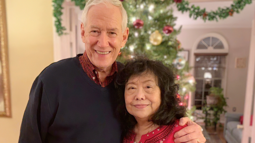 In this December, 2018 photo released by the Stemberger family, Victor and his wife Han Stemberger, are shown at their home in Centreville, Va. Victor Stemberger sits in a Spanish jail, one year after flying into the country with 2.4 kilograms (more than 5 pounds) of cocaine expertly sewn into bubble jackets in a bag. His family says he knew nothing about the drugs.