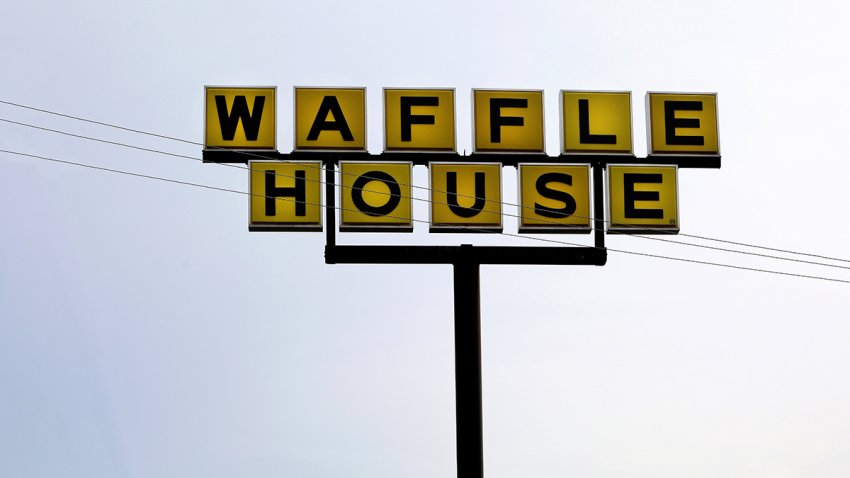 Waffle House restaurant sign, Auburn, Ala., July 6, 2018.