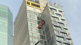 Window washing scaffold danging in Midtown