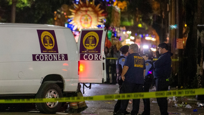 Emergency personnel work the scene after a person was run over and killed by a float in the Mystic Krewe of Nyx parade during Mardi Gras celebrations in New Orleans, Wednesday, Feb. 19, 2020.