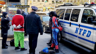 Costumed characters are under NYPD custody for allegedly forming a human wall at Rockefeller Center.