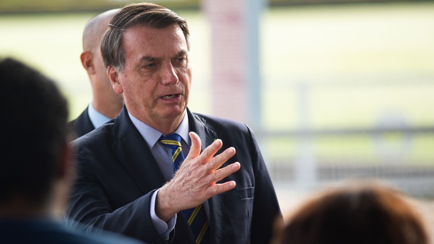 President of Brazil Jair Bolsonaro talks to supporters of his government who waited for him outside the Palácio do Alvorada amidst the coronavirus (COVID-19) pandemic on May 6, 2020 in Brasilia.