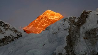 In this Nov. 12, 2015, file photo, Mt. Everest is seen from the way to Kalapatthar in Nepal. Nepal mountaineering authorities have determined that an Indian couple faked a Mount Everest ascent earlier this year by altering photographs to show they were on the summit.Mountaineering Department official Gyanendra Shrestha said the government has canceled the climbing certificate issued to Indian citizens Dinesh and Tarakeshwari Rathod and banned them from climbing any mountain in the Himalayan nation for 10 years.
