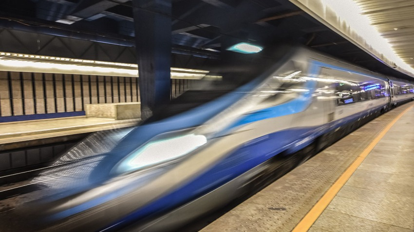 High speed train moves through station