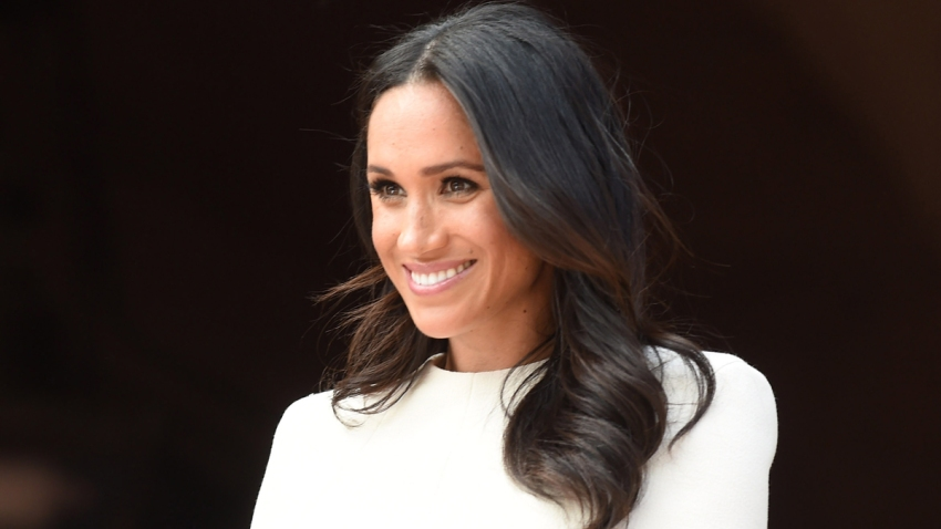 In this June 14, 2018, file photo, Meghan, Duchess of Sussex, and Queen Elizabeth II (not pictured) visit Chester Town Hall in Chester, England.