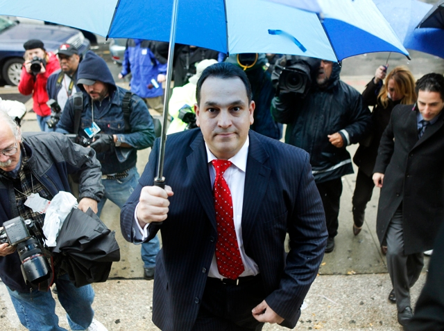 State Senator Hiram Monserrate enters the Queens courthouse in N