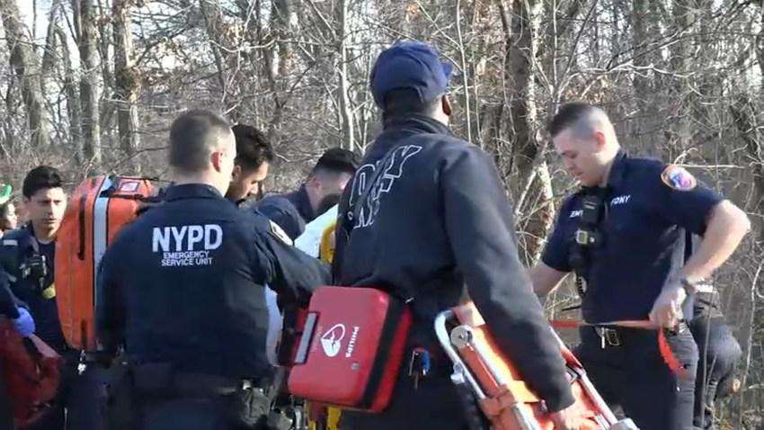 Rescue crews at Queens pond