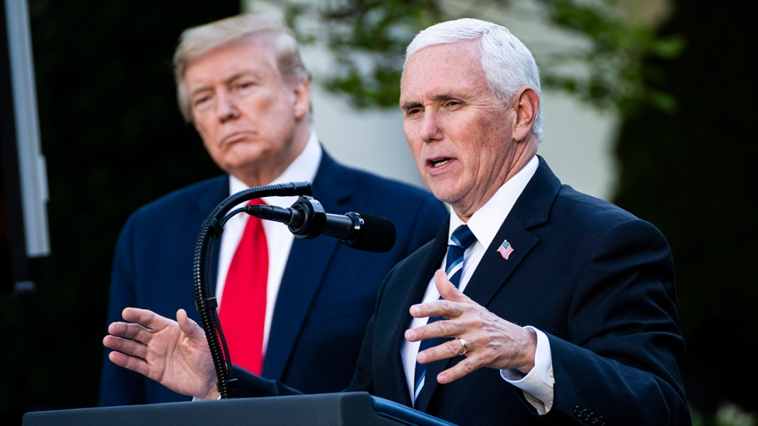 In this April 27, 2020, file photo, Vice President Mike Pence speaks at a briefing about the COVID-19 coronavirus pandemic as President Donald Trump looks on in the White House Rose Garden in Washington, D.C.