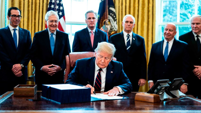 File photo shows US President Donald J. Trump (C) participates in a signing ceremony for the The CARES Act in the Oval Office at the White House in Washington, DC, USA on 27 March 2020. The CARES Act, is a coronavirus COVID-19 stimulus package worth more than two trillion US dollars.