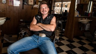In this Aug. 27, 2019, file photo, country singer Morgan Wallen poses for a portrait after getting a mullet at Paul Mole Barber Shop in New York.