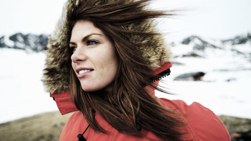 woman wind blowing winter coat