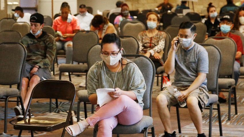 In this July 9, 2020, file photo, people wait to speak with representatives from the Oklahoma Employment Security Commission about unemployment claims in Midwest City, Okla.