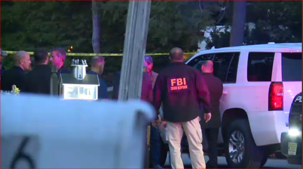 FBI agents at crime scene