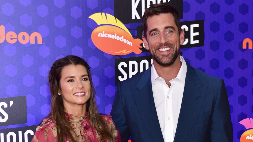 Danica Patrick and Aaron Rodgers attend Nickelodeon Kids' Choice Sports Awards 2018 at Barker Hangar on July 19, 2018, in Santa Monica, California.