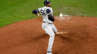 Aroldis Chapman #54 of the New York Yankees pitches in the ninth inning against the Houston Astros