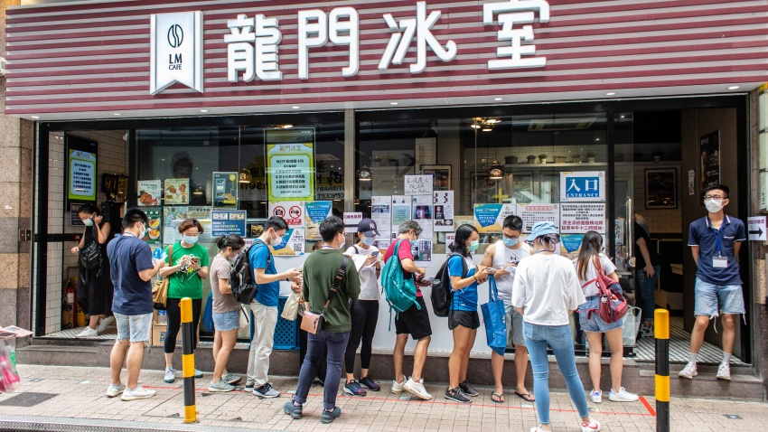 Hong Kong voters queue up at a restaurant to cast their votes.