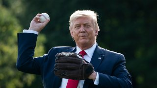 President Trump throwing a baseball