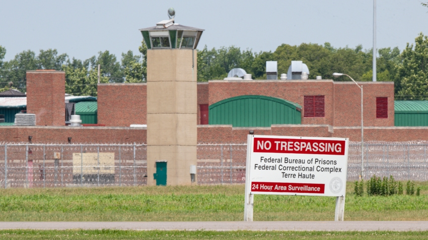This July 15, 2020, file photo shows the entrance to the federal prison in Terre Haute, Ind. A meth kingpin from Iowa who killed five people, including two young girls, is scheduled Friday, July 17, 2020, to become the third federal inmate to be executed this week, following a 17-year pause in federal executions.