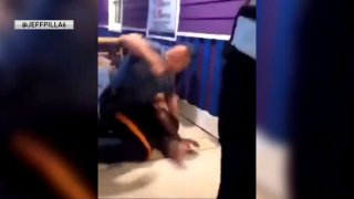 Officer seen hitting suspect on ground