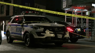 new york city police vehicle sits at scene of deadly crash