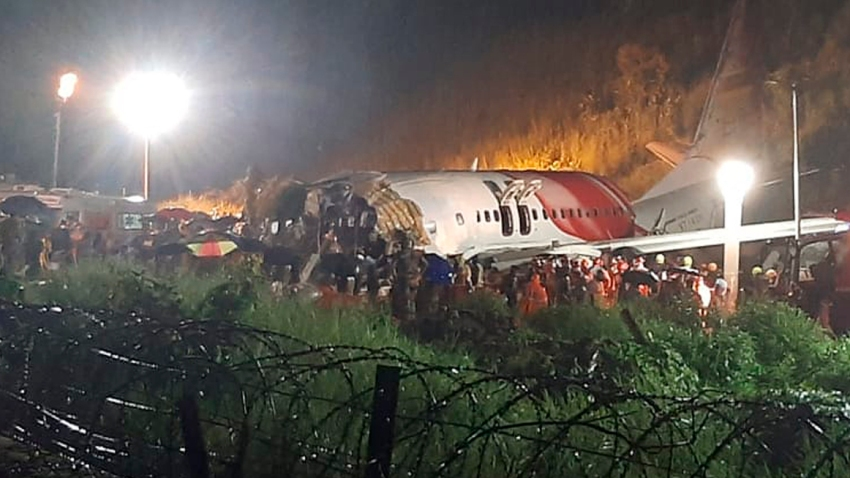 An Air India Express flight skidded off a runway while landing at the airport in Kozhikode, Kerala, India, Friday, Aug. 7, 2020.