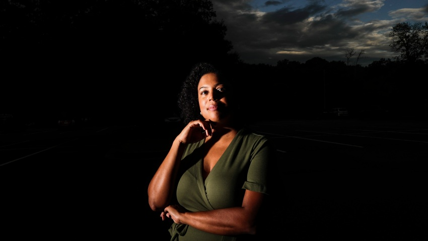 """In this July 24, 2020, file photo, Charisse Davis poses for a portrait in Marietta, Ga. Davis was recently elected the only Black woman on the Cobb County School Board. """"We've been watching from the sidelines and allowing other people to take their turns, and take these positions of power,"""" Davis said. """"Now here we are to essentially fix it."""""""