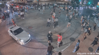Flash mob of people and vehicles