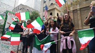 Columbus Day Parade spectators waving Italian flags