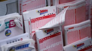 In this Oct. 23, 2018, file photo, Mega Millions lottery tickets sit inside a convenience store in Lower Manhattan in New York City.