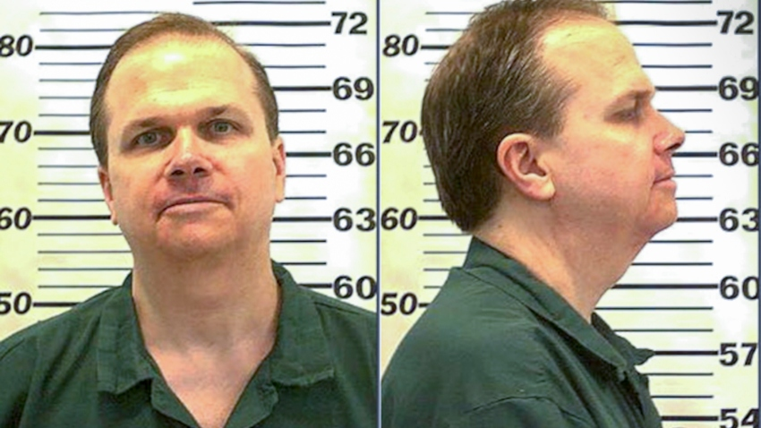 In this handout, American criminal Mark David Chapman in a mug shot taken at the Attica Correctional Facility, July 2010.
