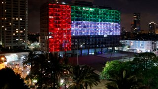 The city hall in the Israeli coastal city of Tel Aviv is lit up in the colors of the United Arab Emirates national flag on August 13, 2020
