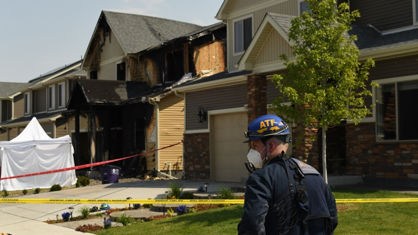Officials investigate a house fire, at 5312 Truckee St., after five people were killed inside on August 5, 2020 in Denver, Colorado.