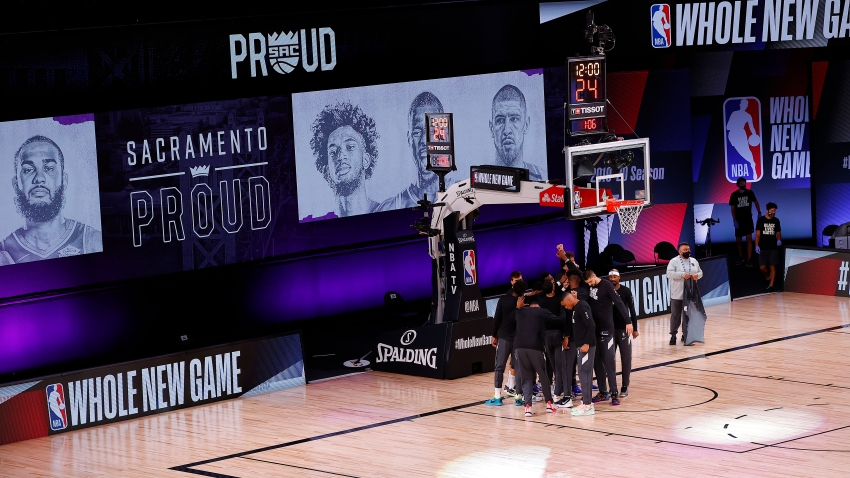 The Sacramento Kings take the court against the New Orleans Pelicans prior to the start of the game of an NBA basketball game Tuesday, Aug. 11, 2020, in Lake Buena Vista, Fla.