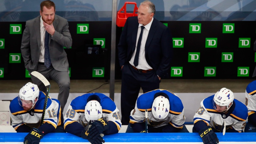 In this Aug. 21, 2020, file photo, head coach Craig Berube and the St. Louis Blues wait on the bench during the closing minutes of their loss to the Vancouver Canucks in Game Six of the Western Conference First Round during the 2020 NHL Stanley Cup Playoffs at Rogers Place in Edmonton, Alberta, Canada.