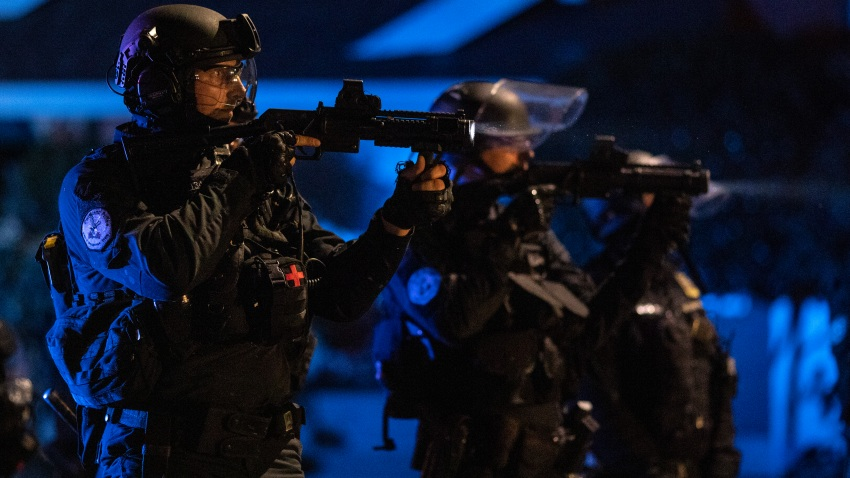 In this Aug. 16, 2020, file photo, Portland police are seen in riot gear during a standoff with protesters in Portland, Oregon.