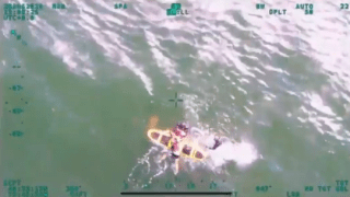 Swimmer being rescued by NYPD Special Ops after being swept by riptide at Rockaway Beach