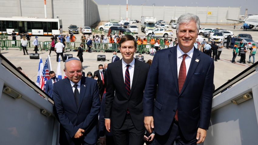Israeli National Security Advisor Meir Ben-Shabbat, left, U.S. President Donald Trump's senior adviser Jared Kushner, center, and U.S. National Security Advisor Robert O'Brien, right, board the Israeli flag carrier El Al's airliner as they fly to Abu Dhabi for talks meant to put final touches on the normalization deal between the United Arab Emirates and Israel, at Ben-Gurion International Airport, near Tel Aviv, Israel Monday, Aug. 31, 2020.