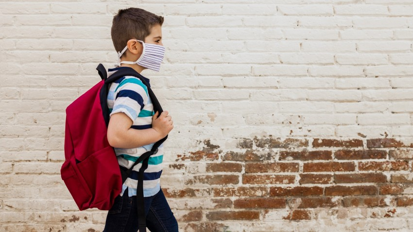 child with face mask backpack