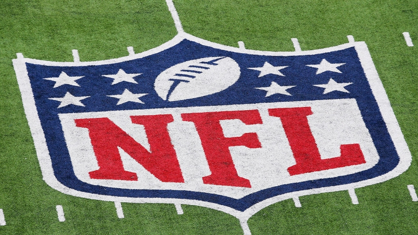 In this Jan. 8, 2012, file photo, a detail of the official National Football League NFL logo is seen painted on the turf as the New York Giants host the Atlanta Falcons during their NFC Wild Card Playoff game at MetLife Stadium in East Rutherford, New Jersey.
