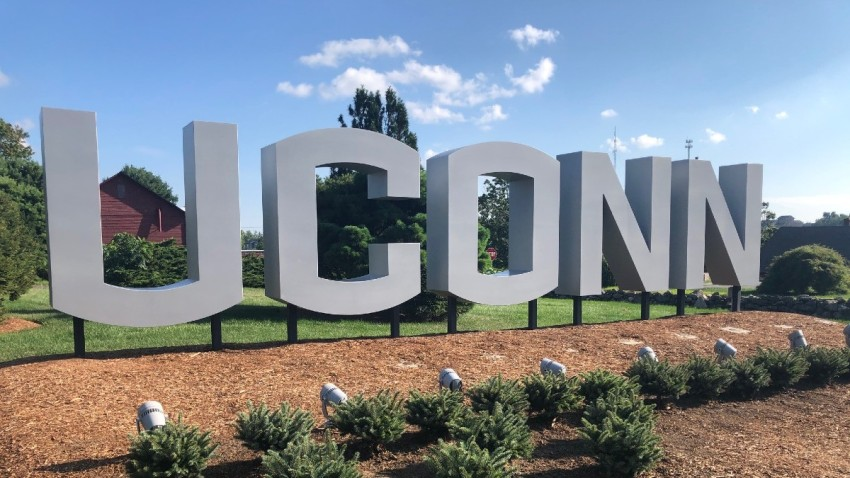a sign spelling out UConn on the school's campus in Storrs