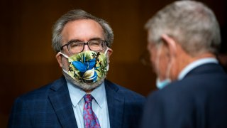 WASHINGTON, DC - MAY 20: Andrew Wheeler, administrator of the Environmental Protection Agency (EPA), wears a face mask as he arrives during a Senate Environment and Public Works Committee hearing, May 20, 2020 on Capitol Hill in Washington, D.C. EPA Administrator Andrew Wheeler will face questions as his agency faces legal challenges and criticism for easing enforcement during the COVID-19 pandemic and rolling back vehicle emissions rules.