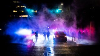 Portland police disperse a crowd on September 23, 2020 in Portland, United States